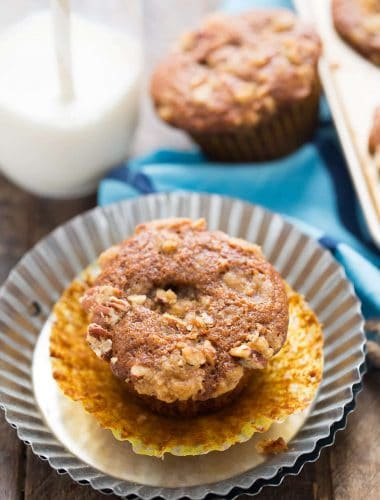 Soft gingerbread muffins with a rich cheesecake center and a streusel topping! Breakfast just got better!