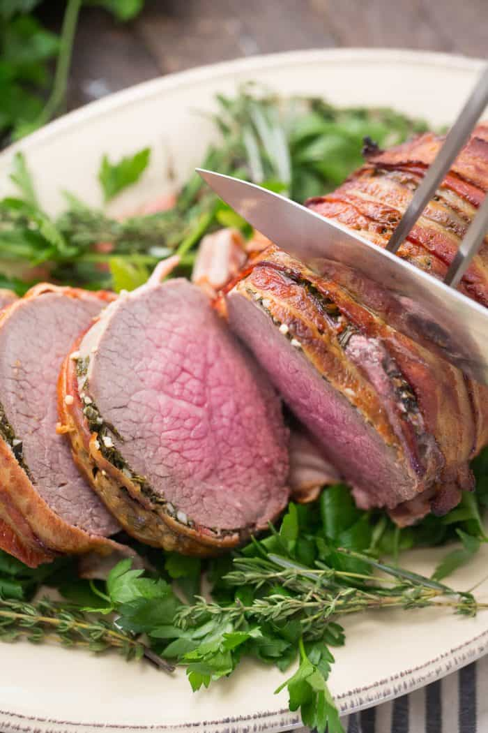 This bacon wrapped eye of round roast is mouth watering! It will be your go-to roast for any occasion!