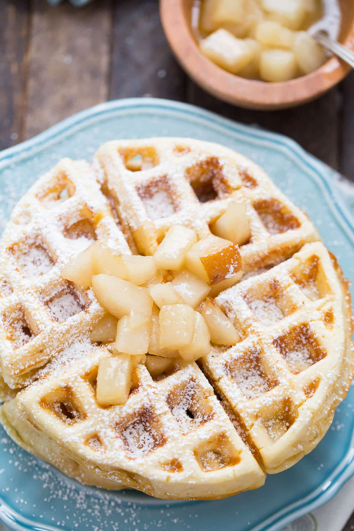 Homemade waffles are flavored with browned butter and are topped with tender spiced pears!