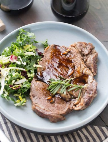 Pan-Seared ribeye steaks are lightly seasoned and cooked to perfection! The Kahlua sauce is a must!
