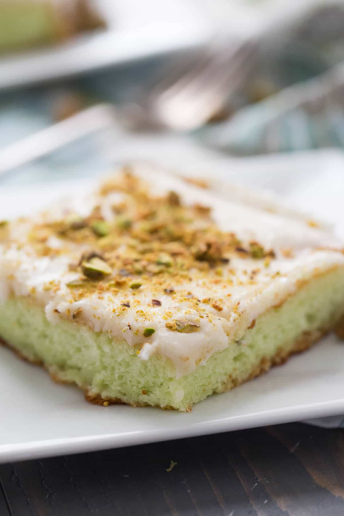 This pistachio pudding cake is so soft, it melts in your mouth! The icing is perfectly dreamy!