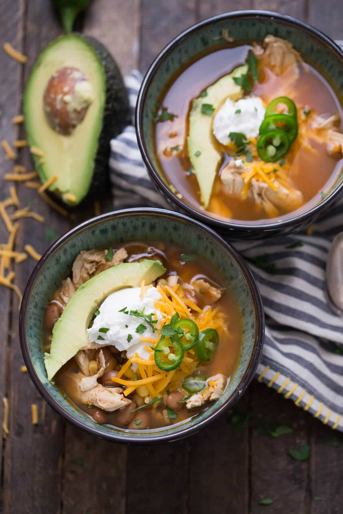 This slow cooker chicken chili is so satisfying! Let the slow cooker do all the work for you with this recipe!