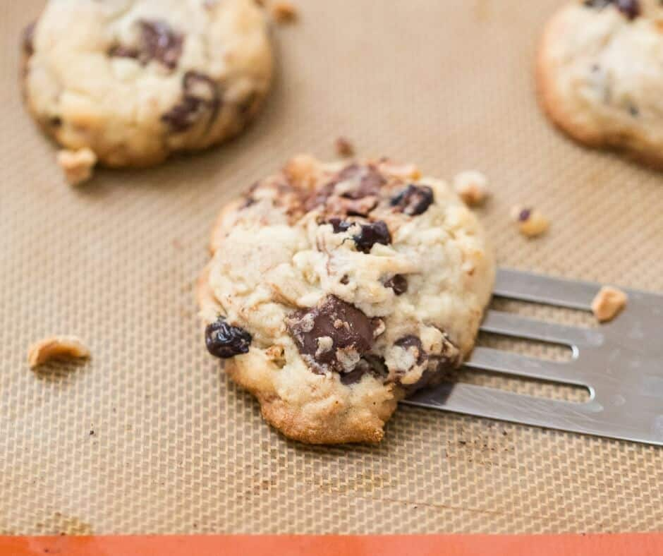 These cherry chip cookies are choc-full of dark chocolate chunks, boozy soaked cherries and chopped hazelnuts!