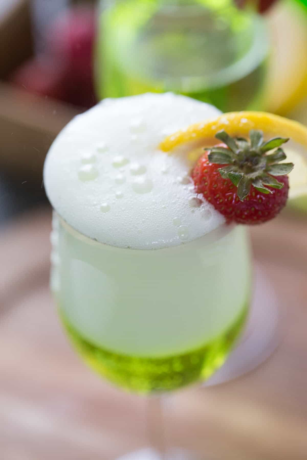 """Prosecco adds the """"bubbly"""" in this fun Irish cocktail! Midori and lemon finish it off!"""