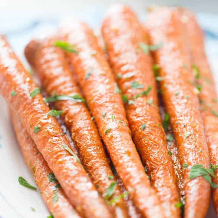 Oven roasted carrots coated in garlic and parsley are simple and delicious! You are going to love them!