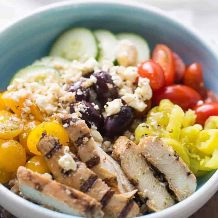 Mediterranean chicken bowl with lots of fresh veggies and healthy farrow! This dish cannot be beat!