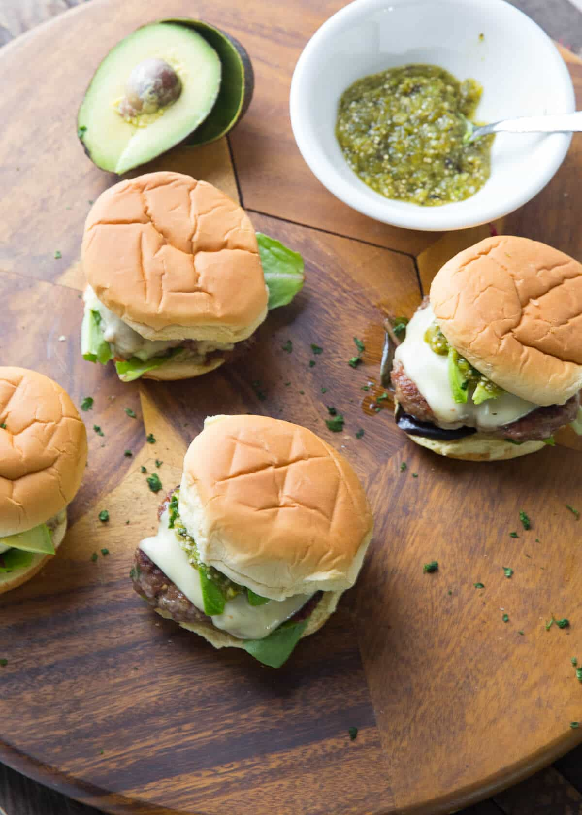 These pork burger and juicy and loaded with flavor from the inside out! You are going to love the simple chile verde sauce!