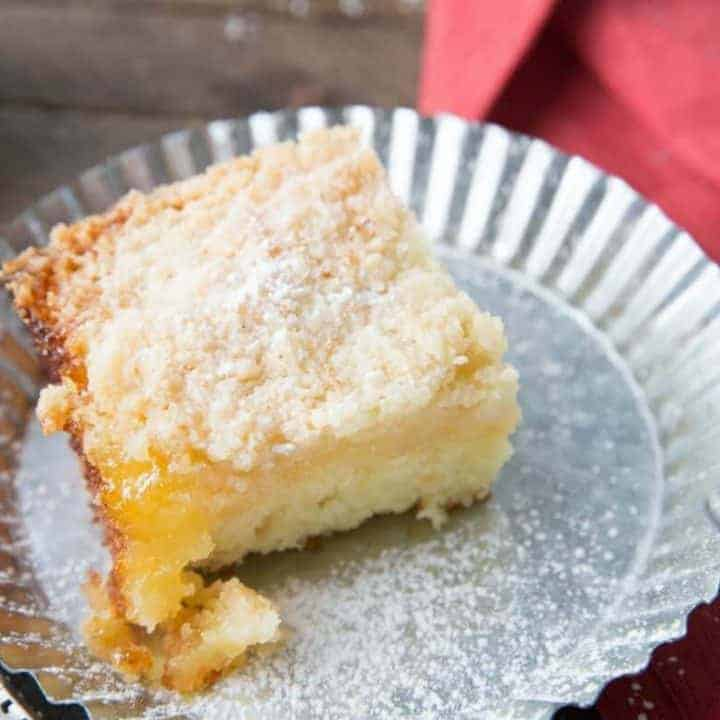 This tender crumb cake is so fluffy and moist! It has a tart lemon curd layer and a buttery crumb topping!