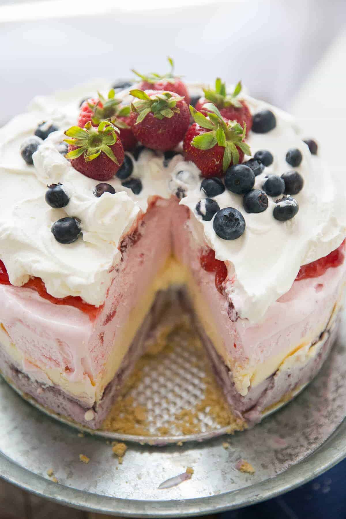 This Red, White, and Blue Ice Cream Cake is the best way to kick off the summer! This cake is so easy, yet looks so impressive!