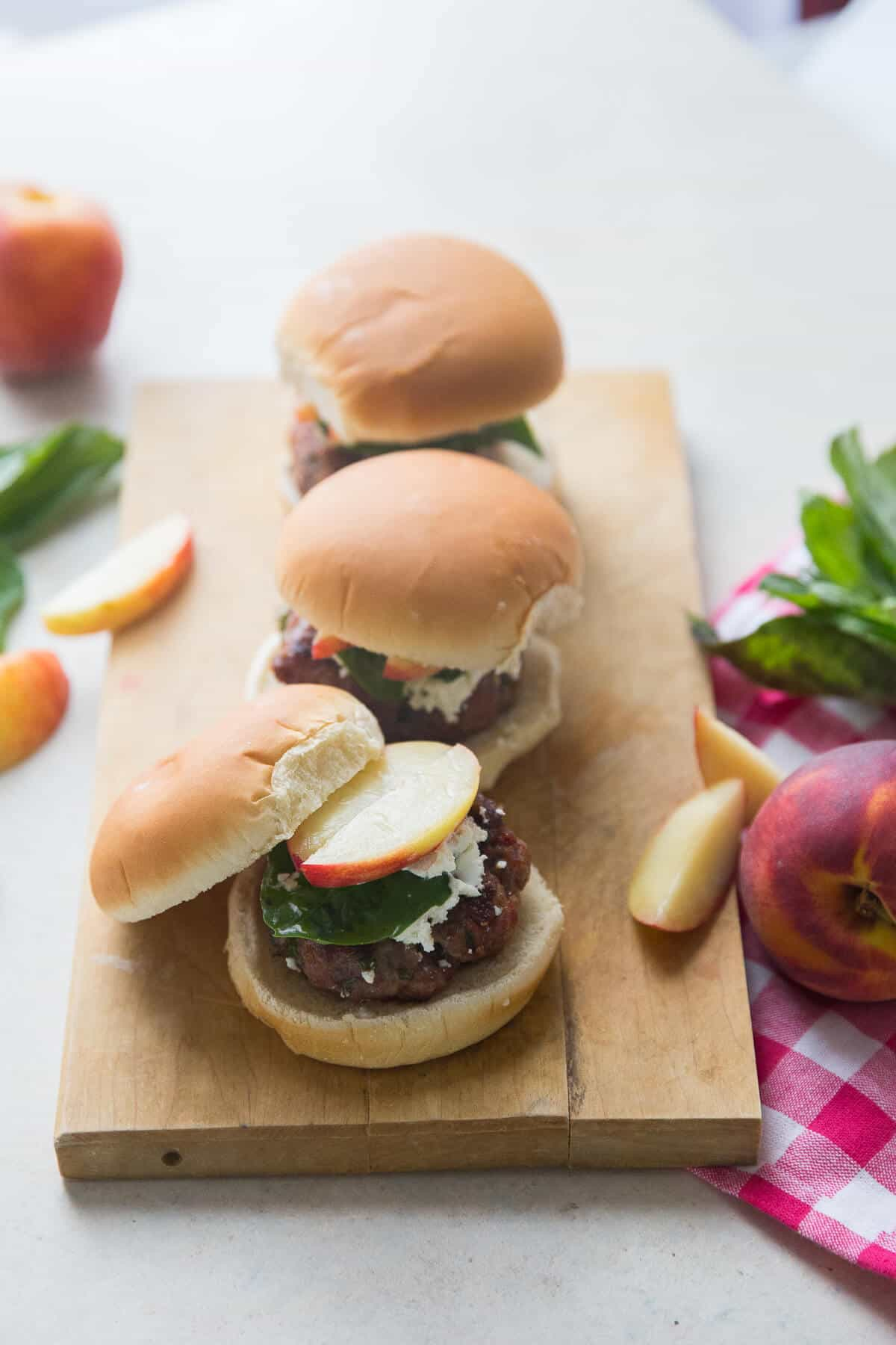 This pork burger recipe is simple yet flavorful and topped with fresh ingredients!