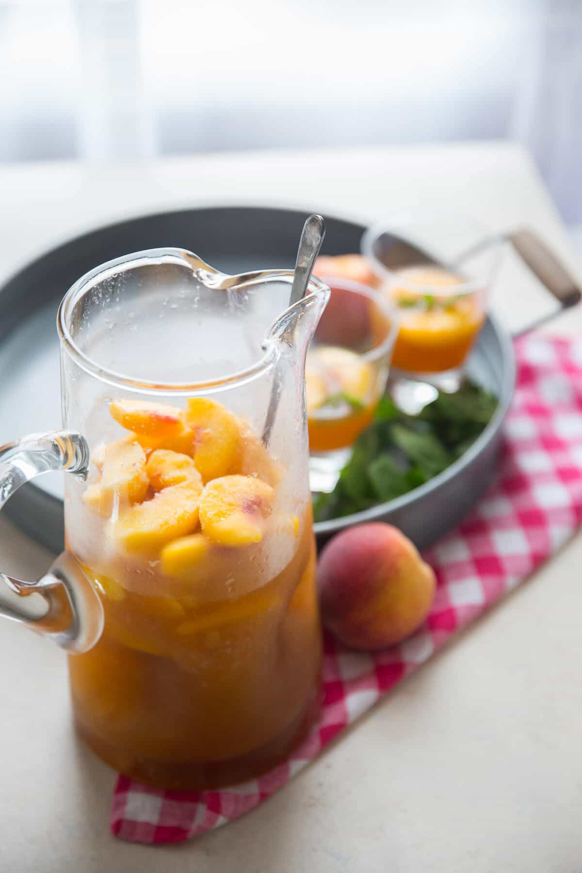 This peachy bourbon slush punch is a whole lot of summer in each glass! You are going to love this sweet peach version!