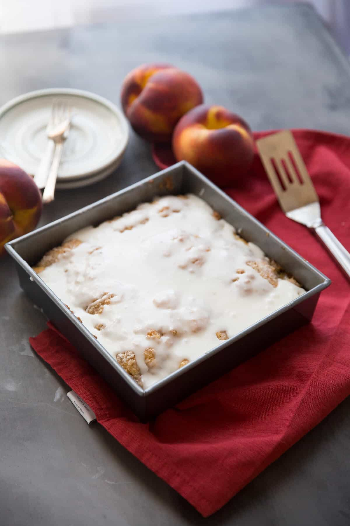 This peaches and cream coffee cake is sure to delight! Sweet peaches, a little cinnamon and a creamy glaze make a delicious treat!