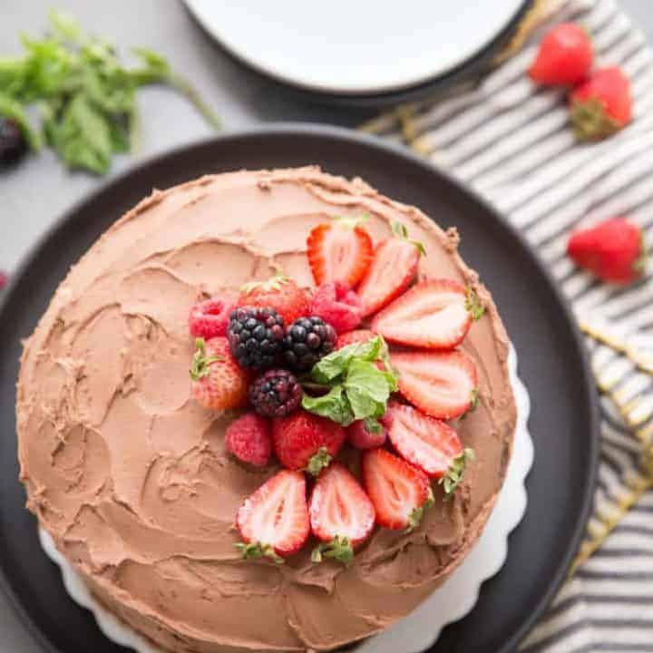 Whole chocolate cake with fruit on top