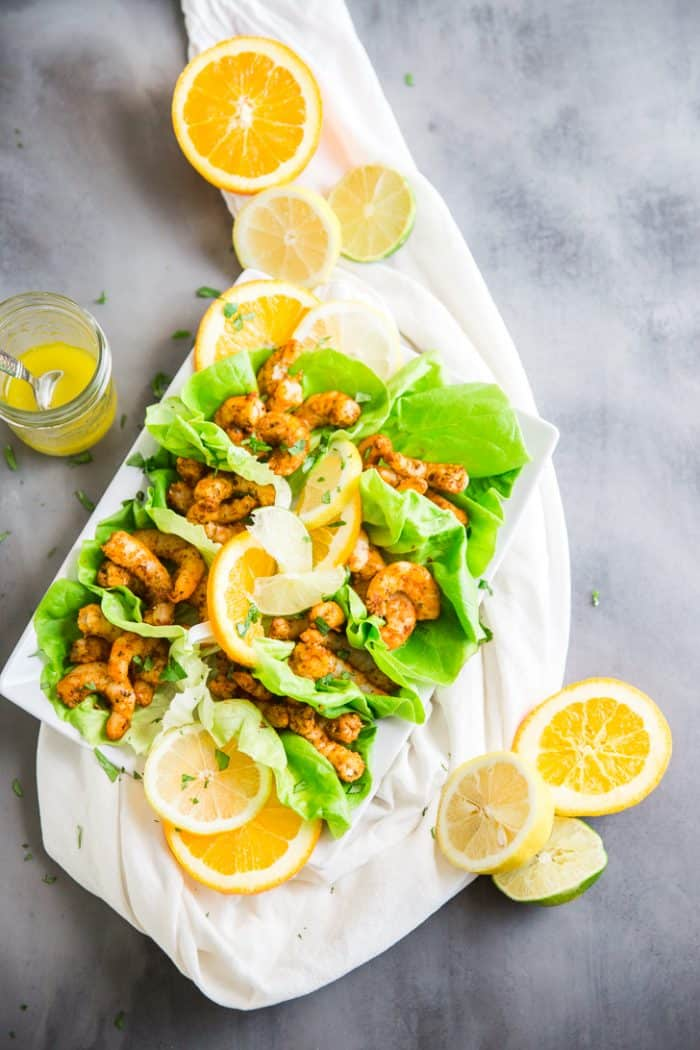 Shrimp tacos in lettuce with dressing on the side
