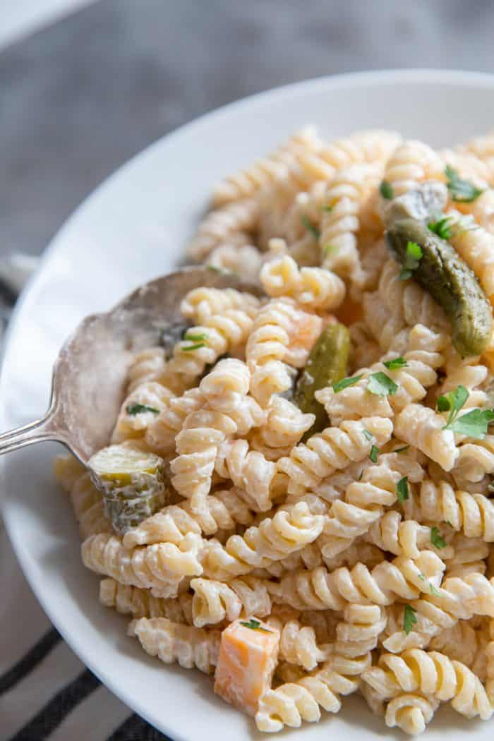 dill pickle pasta salad spoon on the left