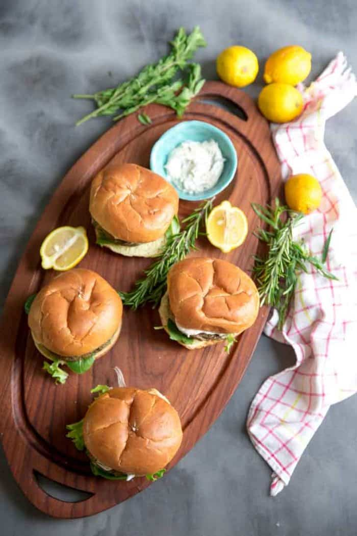 Lemon aioli with turkey burgers on a tray with a bowl of aioli