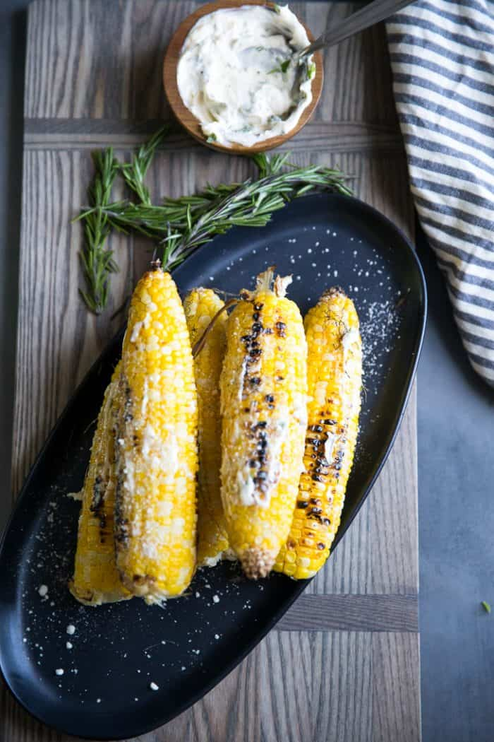 Grilled corn on a serving tray