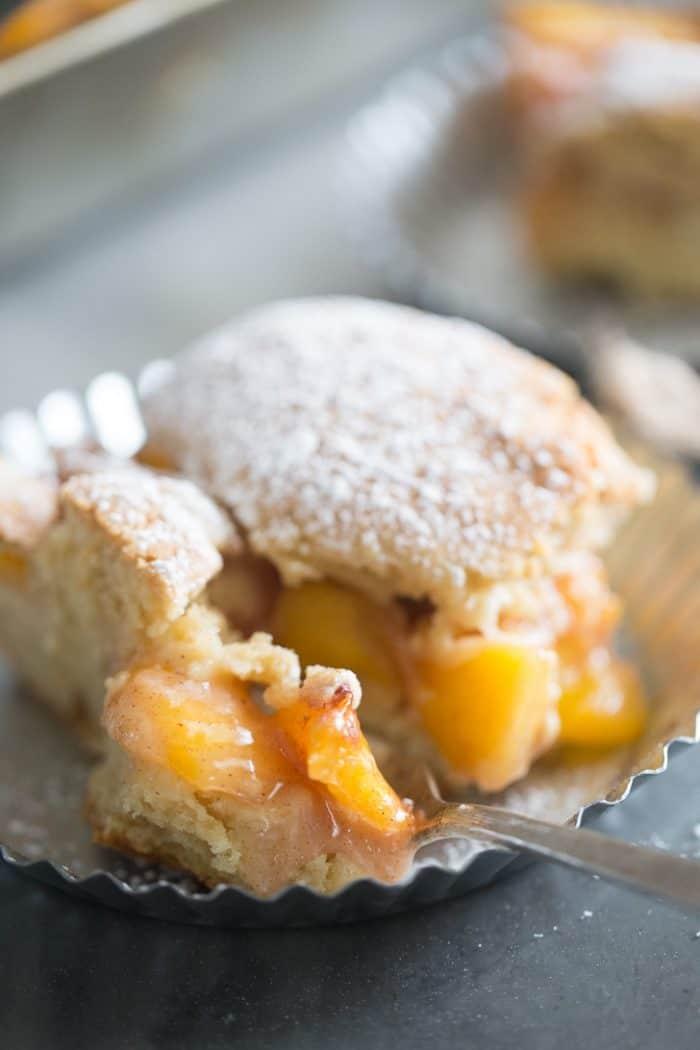 peach cobbler bars close up on a bite