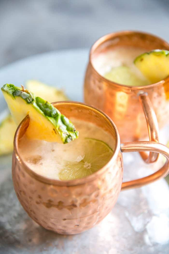 Moscow mule drink with pineapple wedge