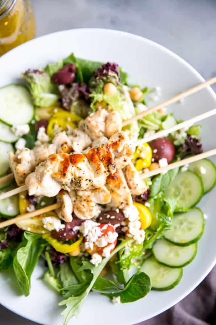 chicken souvlaki over salad