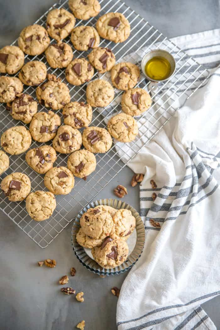 chocolate chip walnut cookies on a dish and baking rack