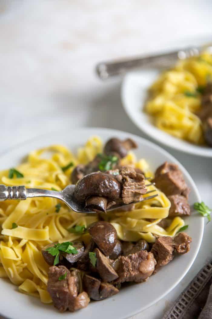 crockpot beef tips fork holding beef