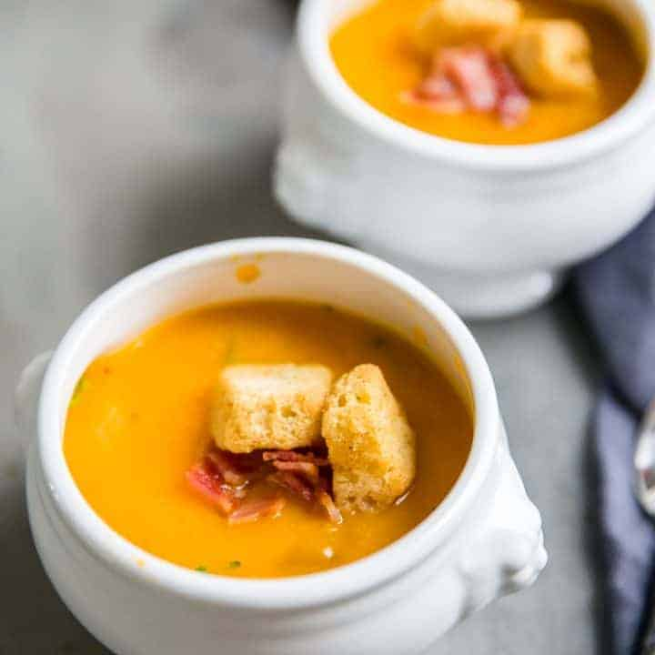 roasted butternut squash soup two white bowls