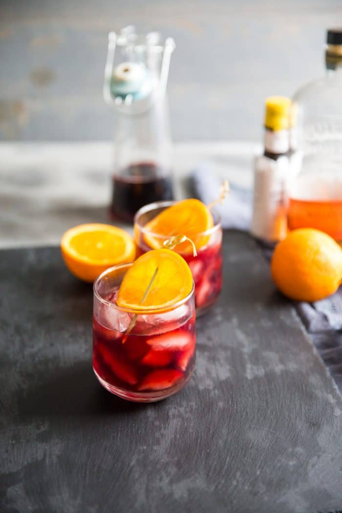 Pomegranate old fashioned cocktail recipe on slate