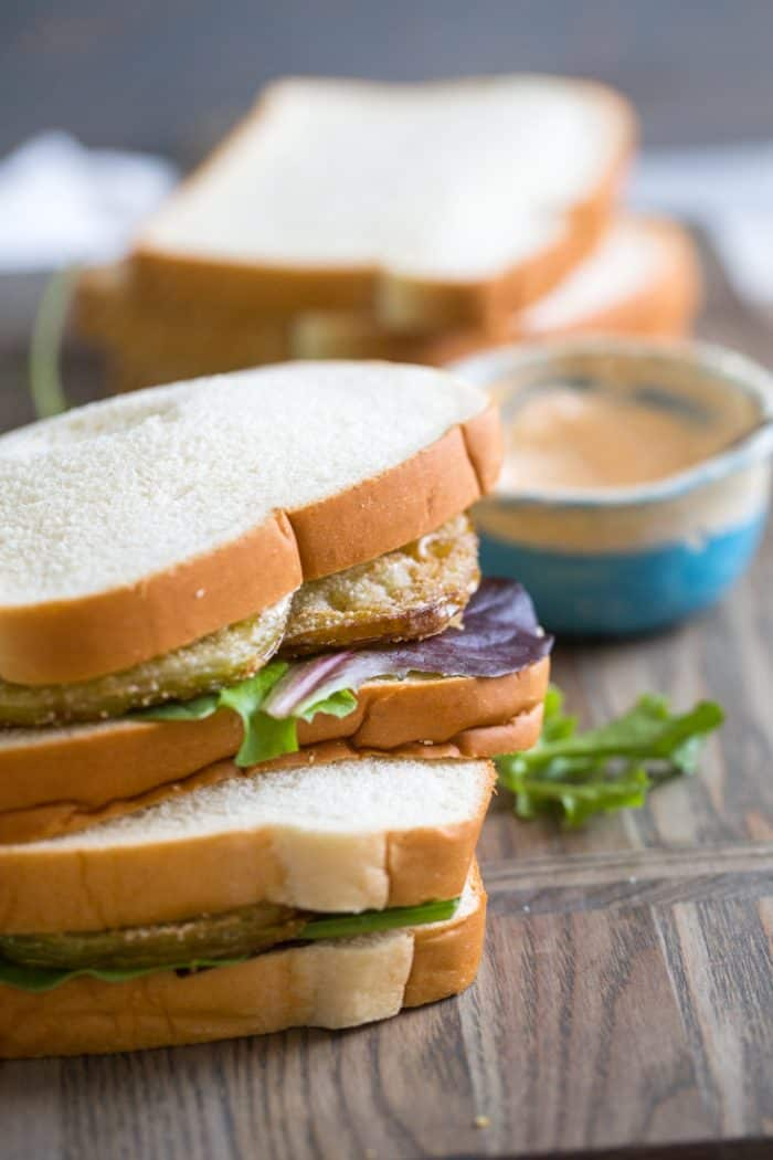 Two fried green tomatoes blt sandwiches stacked