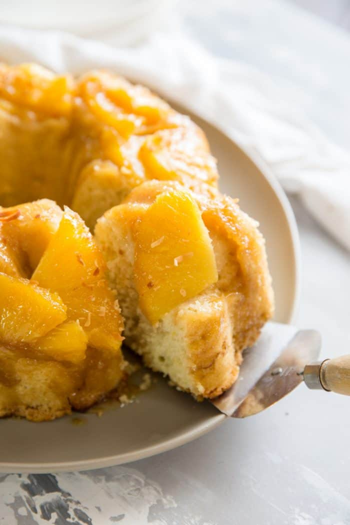 rum cake with a slice being removed