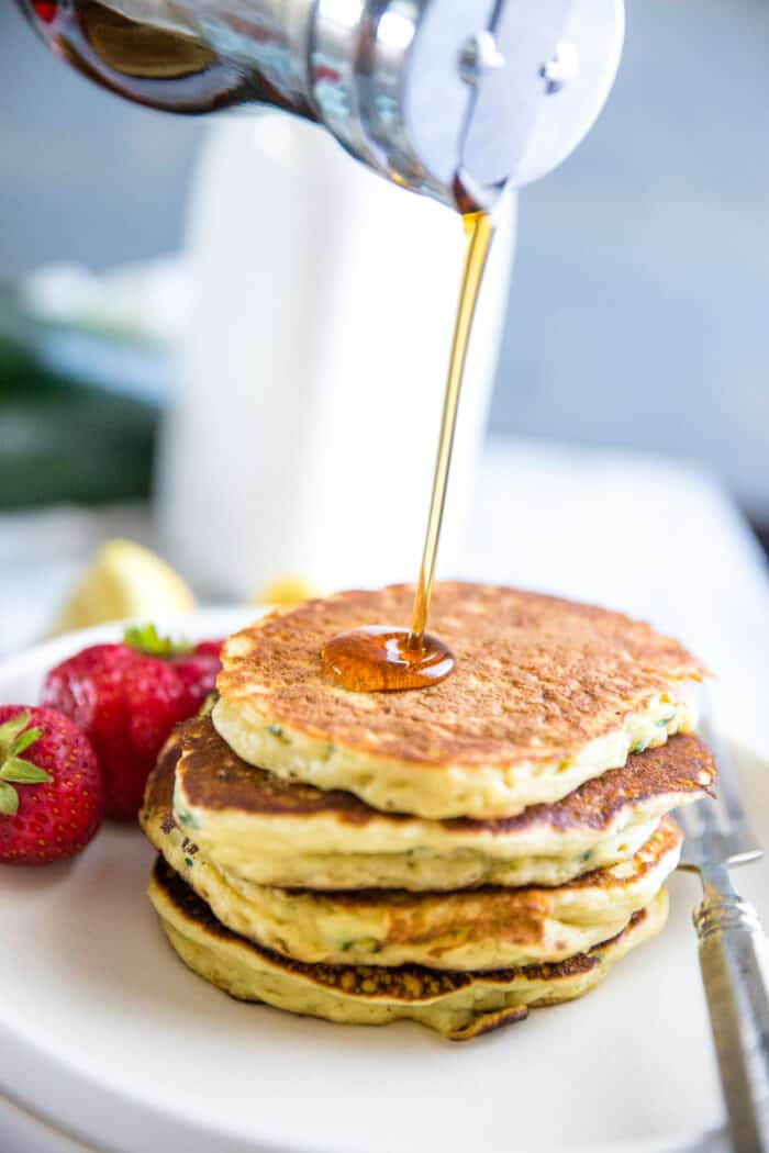 zucchini pancakes syrup pour