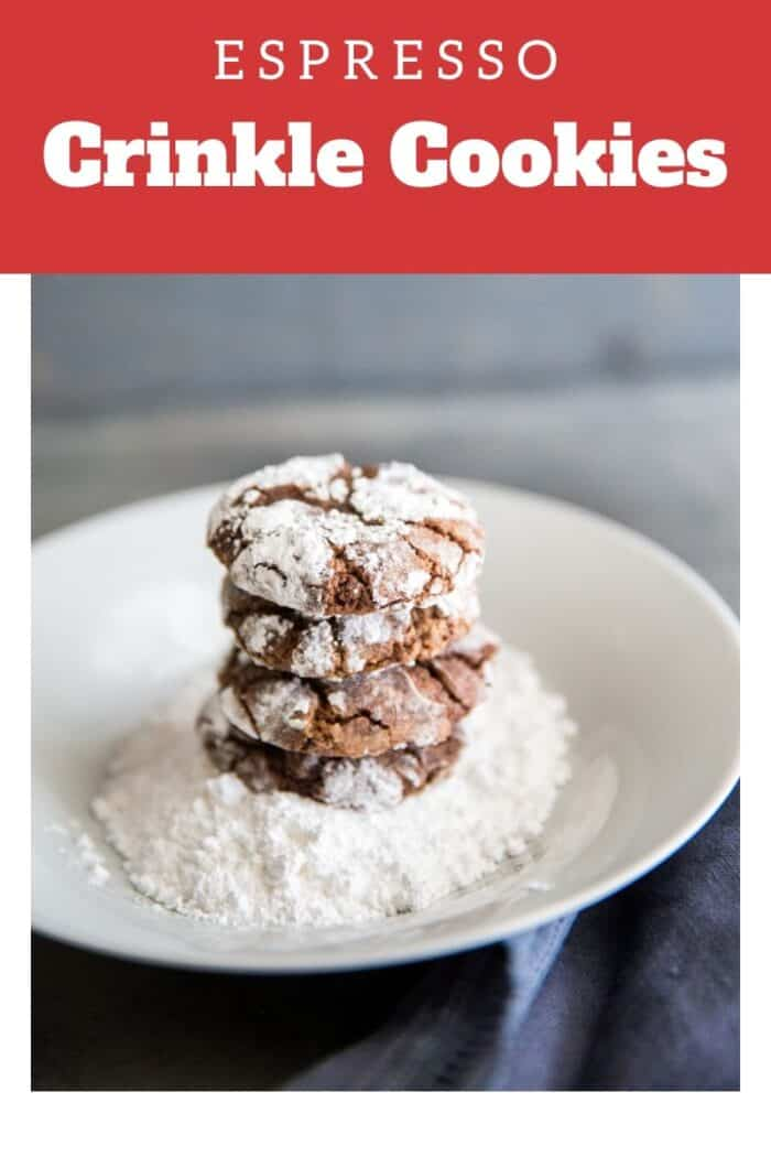 Chocolate crinkle cookies stacked on a plate