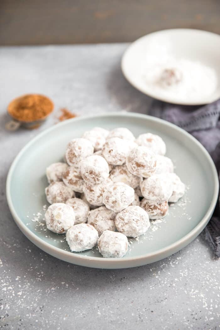 chocolate snowball cookies in a pile