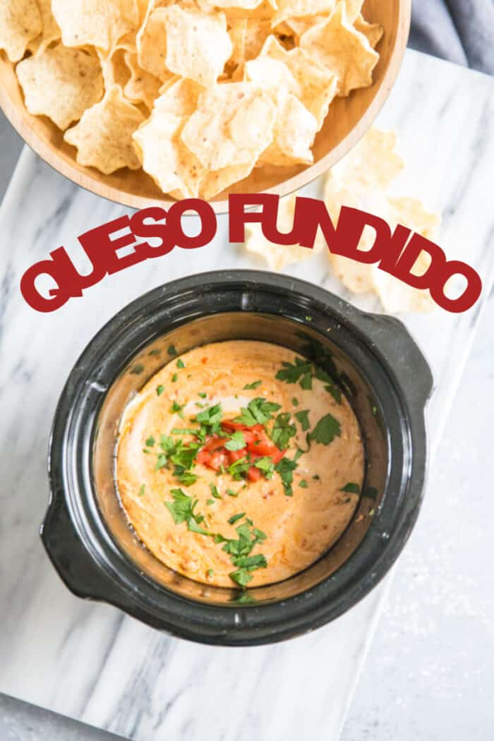 A close up of queso fundido in a crockpot