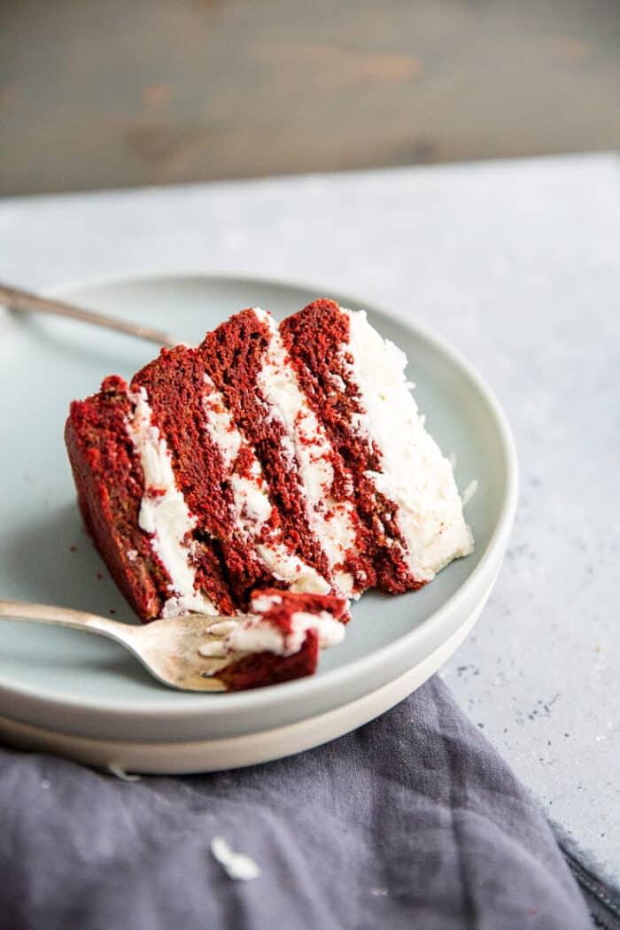 red velvet cookie cake slice with fork