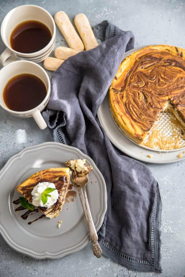 Tiramisu cheesecake with a slice on the side