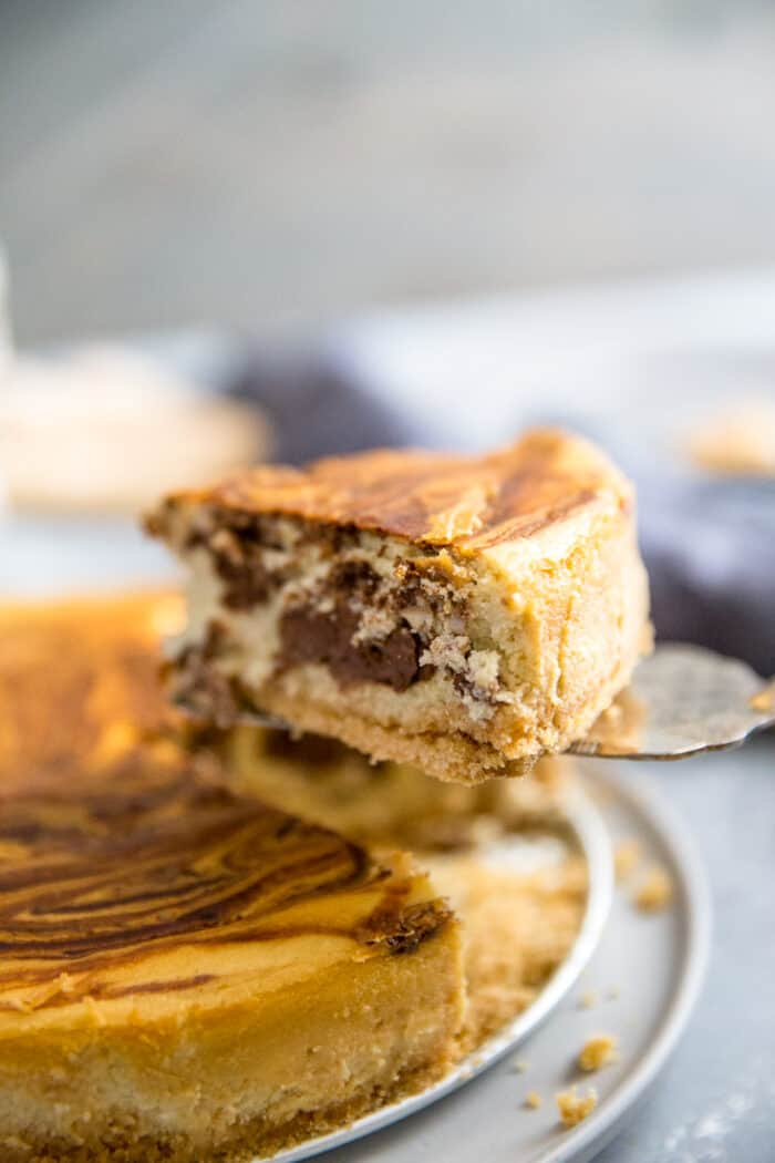 Tiramisu Cheesecake with a slice being served
