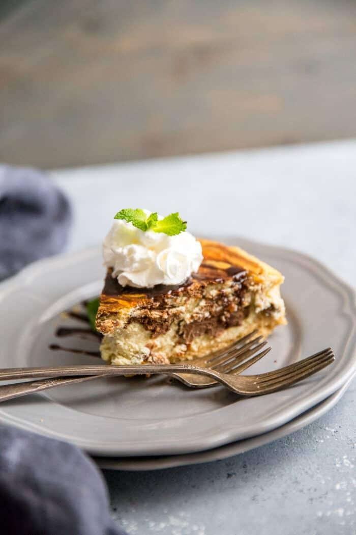 Tiramisu cheesecake slice on gray plate