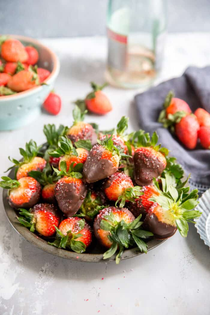 a bowl of chocolate covered strawberries