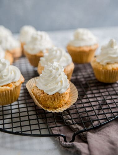 carrot cake cupcakes on a baking rack