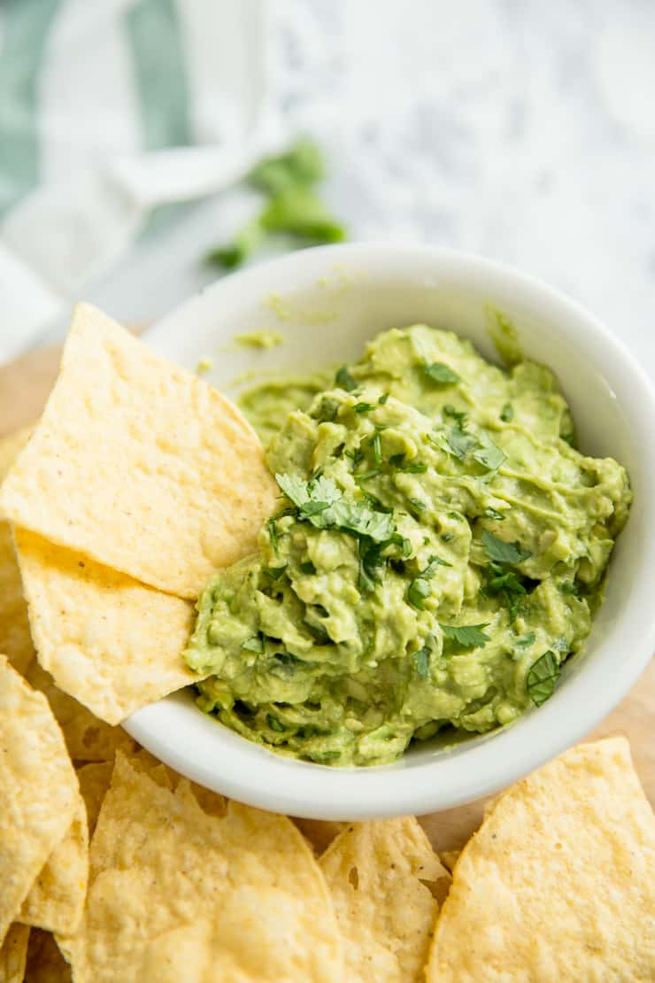 easy guacamole two chips in the bowl