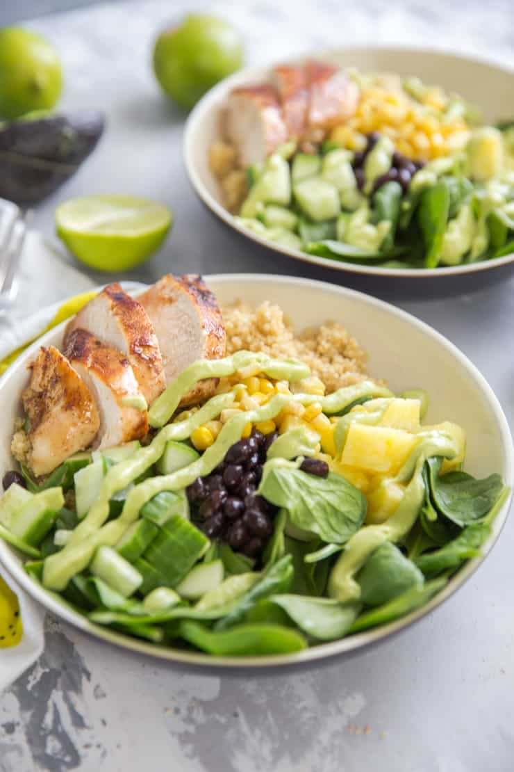 jamaican jerk chicken in a bowl with fruits and veggies