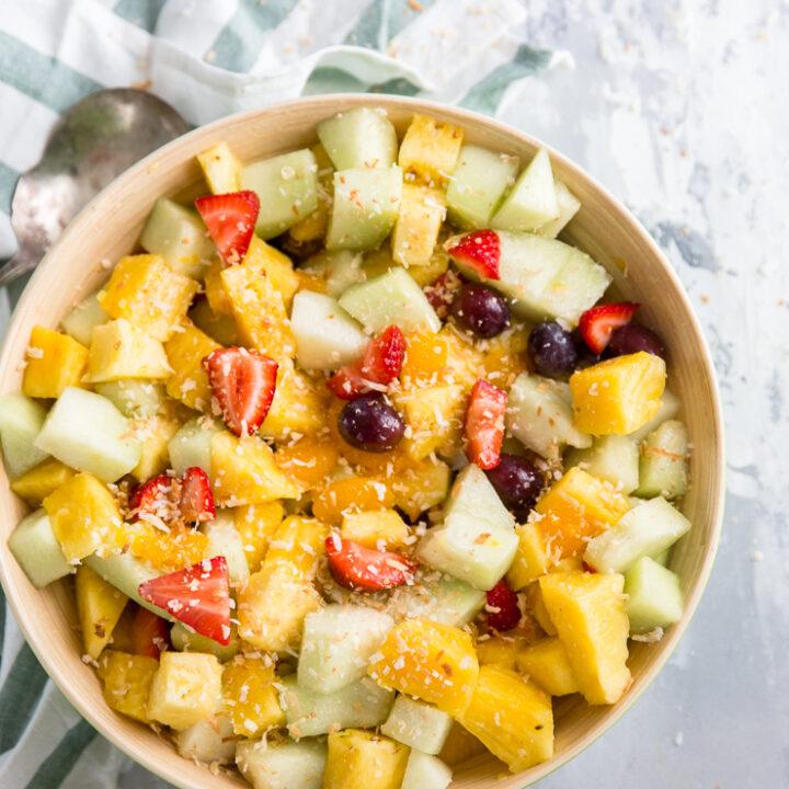 fruit salad in a tan bowl
