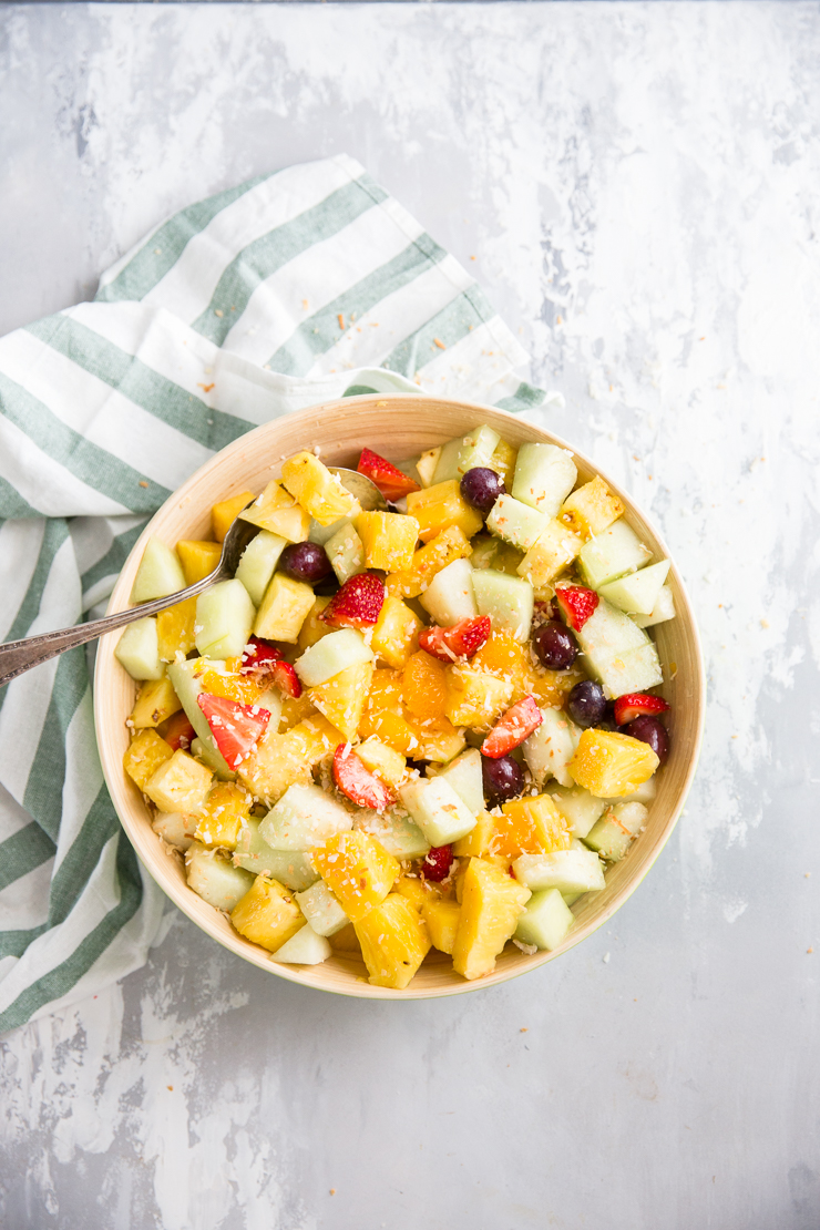 fruit salad bowl with a spoon on the side