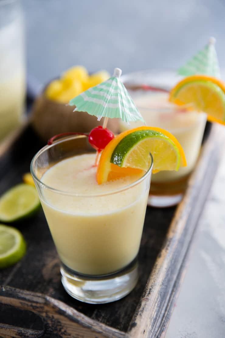 virgin pina colada drink with a drink umbrella