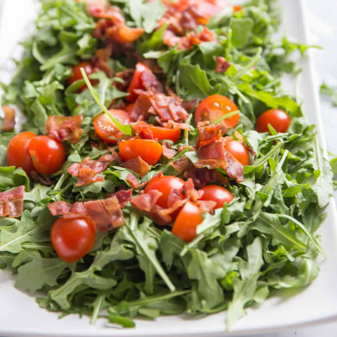 blt salad with tomatoes and bacon on top