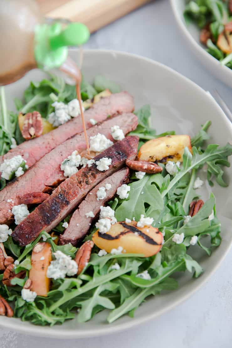black and blue steak with dressing poured