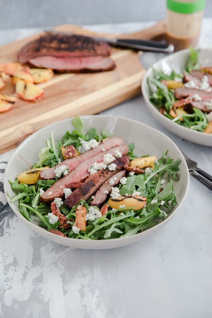 black and blue steak with greens