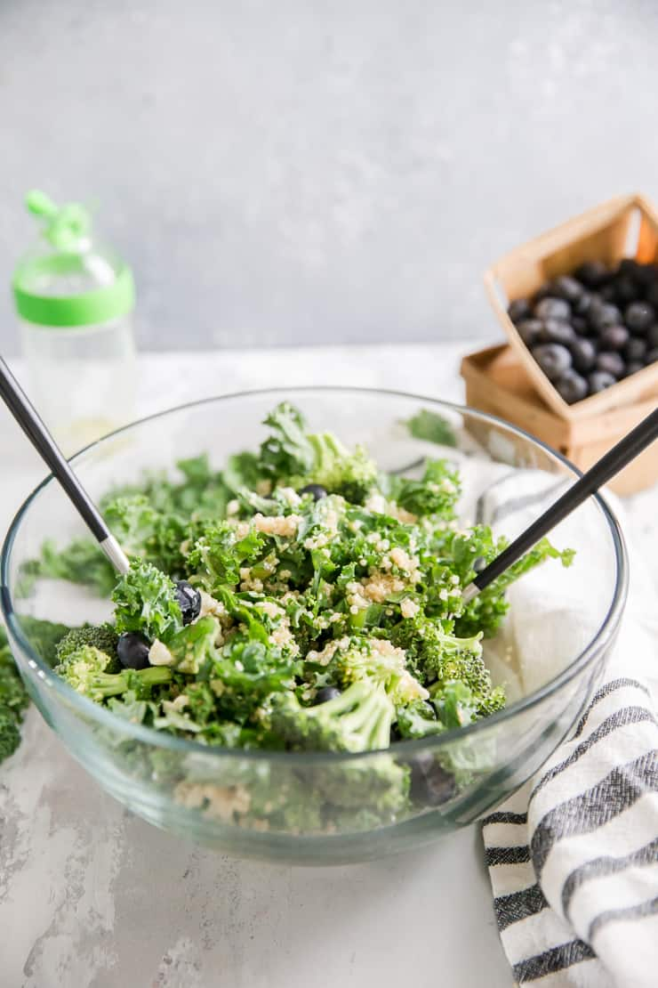 quinoa salad in a bowl with salad spoons