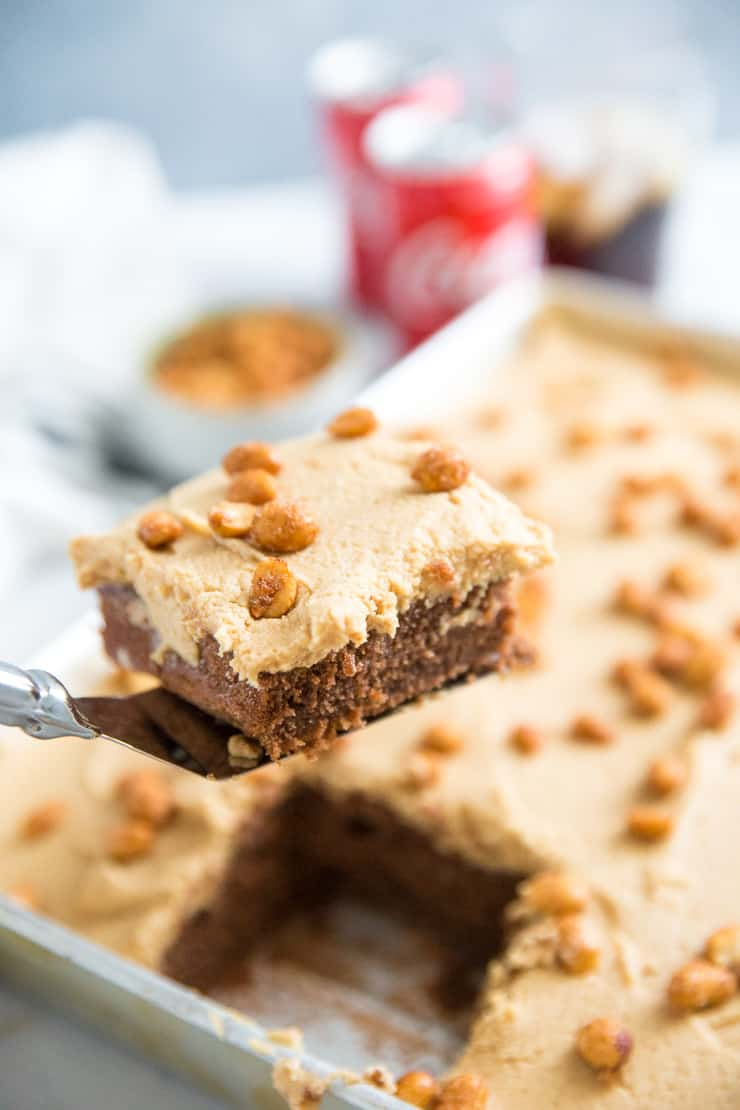 piece of peanuts and coke cake being lifted out of pan